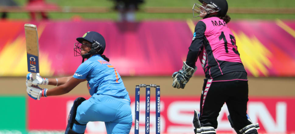 Katey Martin looks on as Indian star Harmanpreet Kaur smacks the ball out of the ground in Guyana during the T20I World Cup. Photo: Getty Images