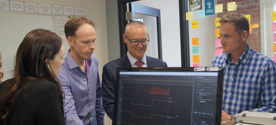 Prime Minister Jacinda Ardern watches on as Health Minister David Clark's blood pressure reading is displayed. Photo: Sam Sachdeva.