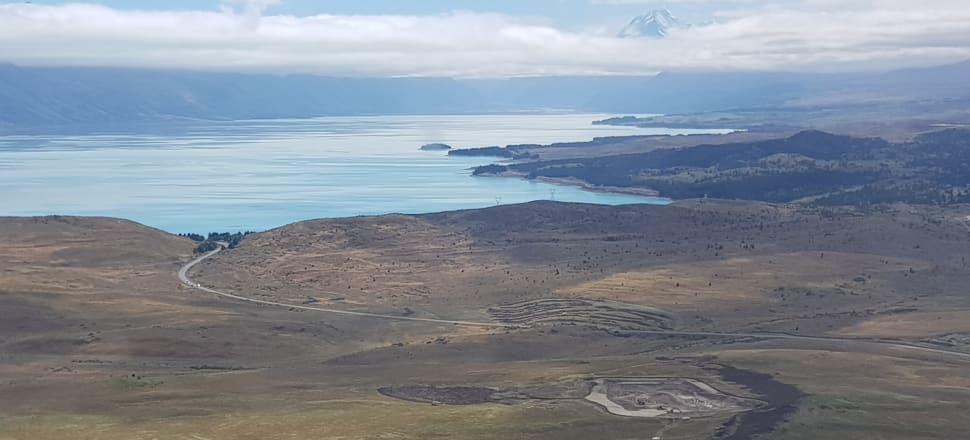 An aerial view in March of a dairy development at Simons Pass Station, with Lake Pukaki in the background. Photo: DOC
