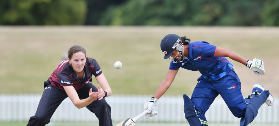Auckland Hearts cricketer - and Samoan captain - Regina Lili'i lunges for the crease to beat Canterbury Magician - and White Ferns captain - Amy Satterthwaite. Photo: Getty Images.