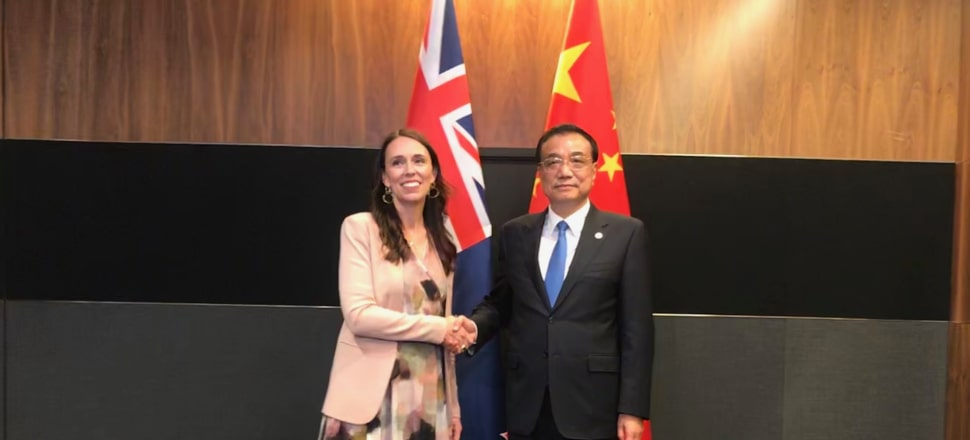 Jacinda Ardern says NZ's geography and reliance on trade means retreating into protectionism isn't an option - something she's made clear in her meetings with leaders from China (pictured with Premier Li Keqiang) and the US. Photo: Laura Walters