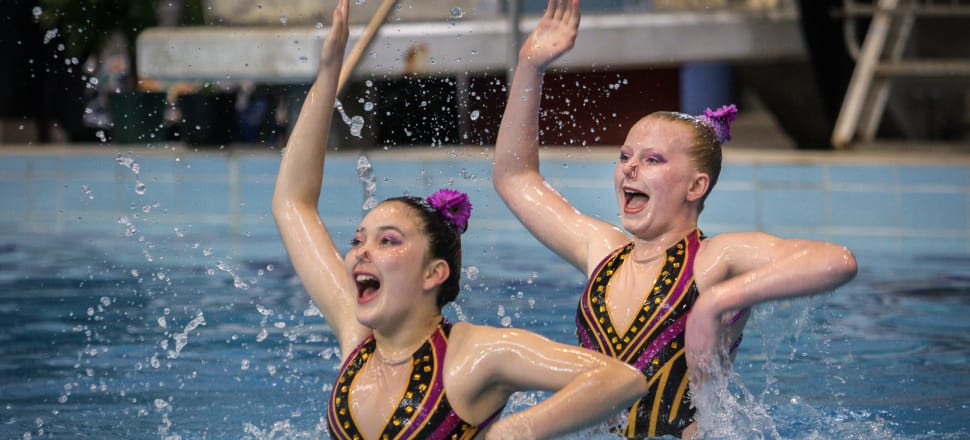 Emma Goldthorpe and Klara Sharplin, from the North Harbour club, perform a duet at the national synchronised swimming championships at WestWave. Photo: Gail Stent Photography.
