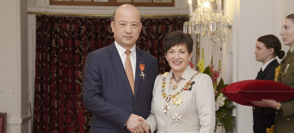 Zhang Yikun receives his MNZM honour from Governor-General Dame Patsy Reddy at an investiture ceremony. Photo: Office of the Governor-General