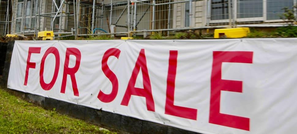 For sale signs on a house in Whangaparoa. Photo: John Sefton