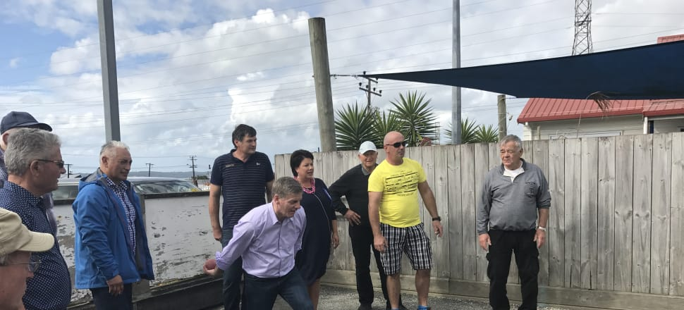Bill English's last throw - trying Buce, Croatian petanque, in West Auckland yesterday.