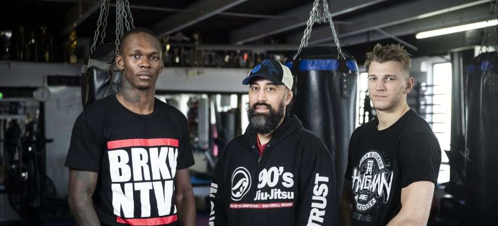 Fighting out of Auckland's Central Kickboxing gym under the watchful eye of head coach Eugene Bareman (centre), Israel Adesanya (left) and Dan Hooker are storming up the UFC rankings. Photo: supplied