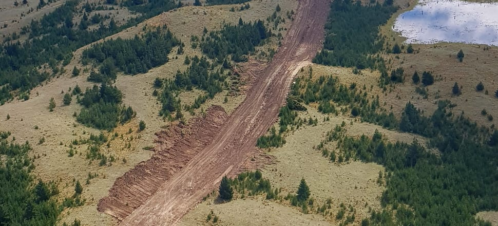 A track on the Irishman Creek Conservation Area cleared for an irrigation pipeline trench. Photo: DOC