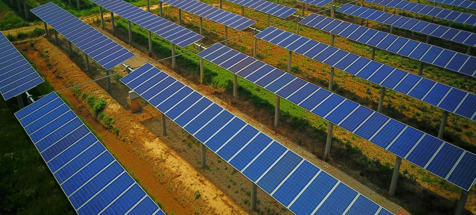 China's move into solar energy and other renewables is motivated by concerns both local and farther afield. Photo: Barcroft Media via Getty Images.