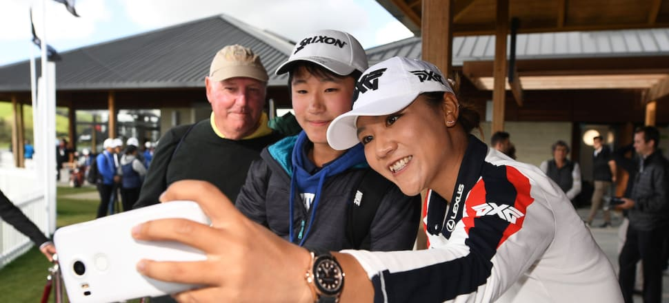 Golf's number one Lydia Ko lines up a different kind of shot for a fan. Photo: Photosport