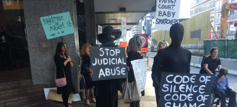 Women protest outside the Family Court in Auckland. Photo: Cass Mason