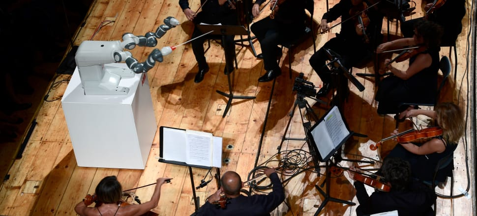 Robot conductor 'Yumi' last week made its debut before an orchestra in Italy - it lacked artistry, but it's getting there. Photo: Getty Images
