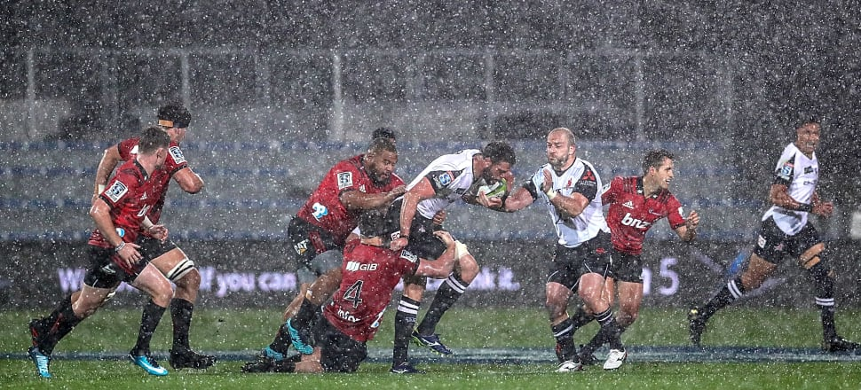 The Crusaders are pelted with hailstones as they play the Sunwolves at AMI Stadium last Saturday. Photo: Getty Images