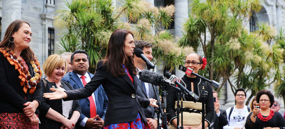 Jacinda Ardern greets the crowd on her return from being sworn in as Prime Minister. Photo: Lynn Grieveson