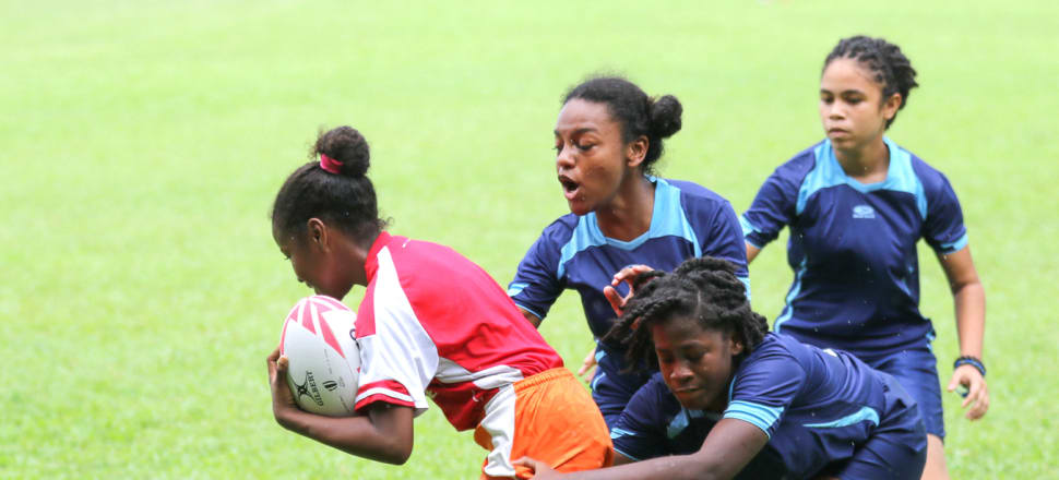 Girls in Trinidad and Tobago are being introduced to the oval ball through global programmes like Get Into Rugby. Photo: World Rugby.