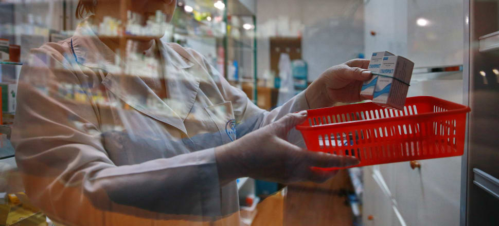 Scenes like this may become a thing of the past at some pharmacies under plans currently being discussed by DHBs. Photo: Getty Images