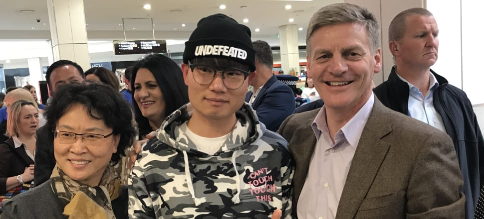 National leader Bill English was determined to have a photo with this man and his Undefeated hat. Photo: Tim Murphy