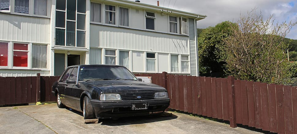 A mid 1980s Ford Falcon parked outside a state house in Porirua. Photo by Lynn Grieveson.