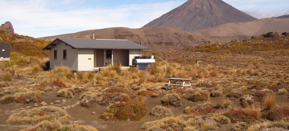 Oturere Hut on the Tongariro Northern Circuit with a view of Mt Ngauruhoe. Photo: Department of Conservation