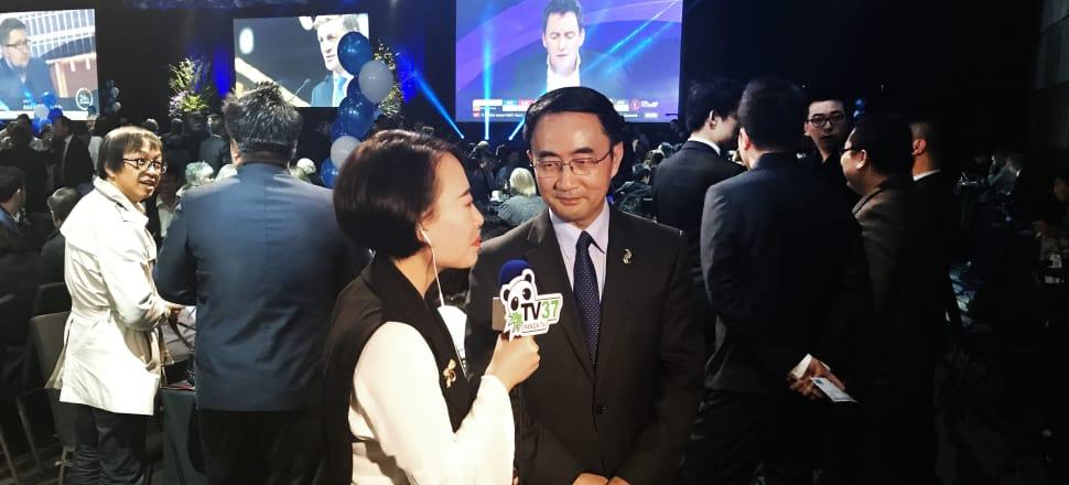 Panda TV interviews Jian Yang during National's election night function in Auckland. Photo: Tim Murphy