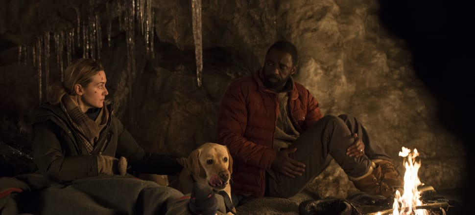 Kate Winslet, Idris Elba, and the miracle dog. Photo: 20th Century Fox