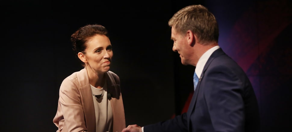 Labour's Jacinda Ardern shakes hands with National's Bill English during TVNZ's first leaders' debate. Photo: Getty Images