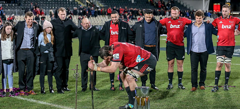 Crusaders captain Sam Whitelock marks the 2018 Super Rugby final victory by stabbing the ground with a sword. Photo: Getty Images