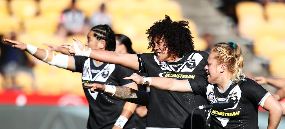 The Kiwi Ferns - performing the haka before their clash with the Jillaroos last year - will be expected to play like rugby league professionals under new coach Justin Morgan. Photo: Getty Images.