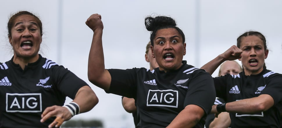 Te Kura Ngata-Aerengamate (centre) leads the kapa haka and waiata for the Black Ferns, and she's also a leader  in play and off the field, helping young Northland girls get active. Photo: Getty Images.