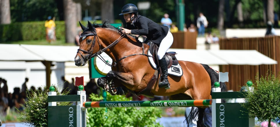 Sam McIntosh riding Check In 2 at a Nations Cup Piazza di Sienna in Italy last year; they've since helped to secure New Zealand a place in showjumping at next year's Tokyo Olympics. Photo: Getty Images.