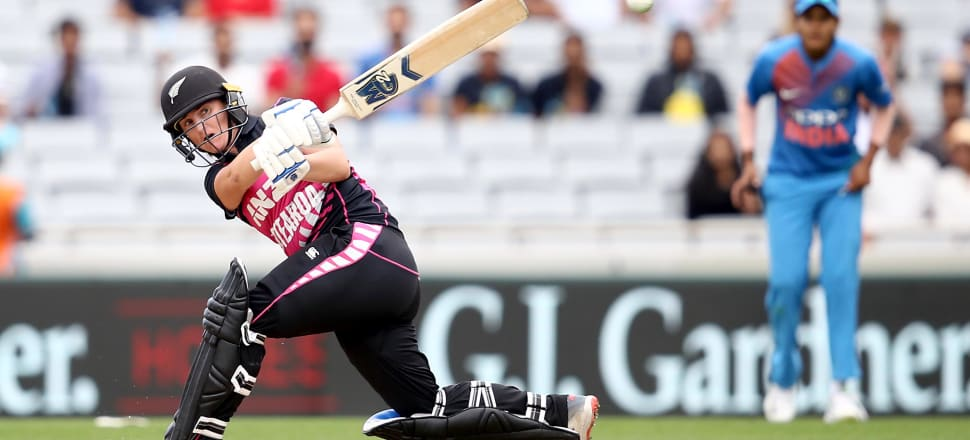 White Fern Katey Martin, in action against India, says the new Master Agreement means women cricketers can focus primarily on playing cricket.  Photo: Getty Images.