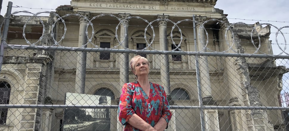 Dr Anna Crighton in front of the other cathedral - the one that won't be rising again. Photo: Sharon Brettkelly