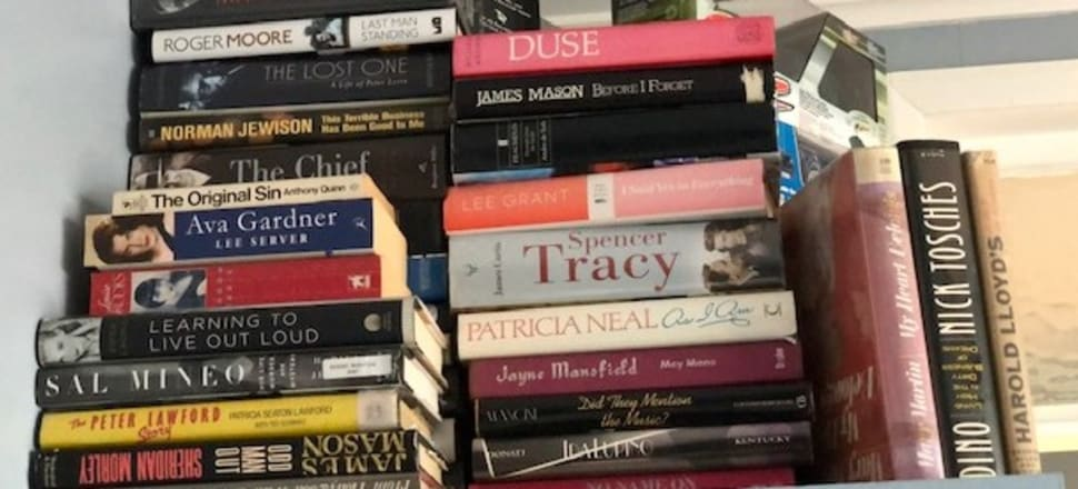 """""""On top of wardrobes, in cupboards or in piles on the floor... anywhere except bookshelves,"""" writes the great Witi Ihimaera, of this photo of popular trash stacked up at his Auckland home."""