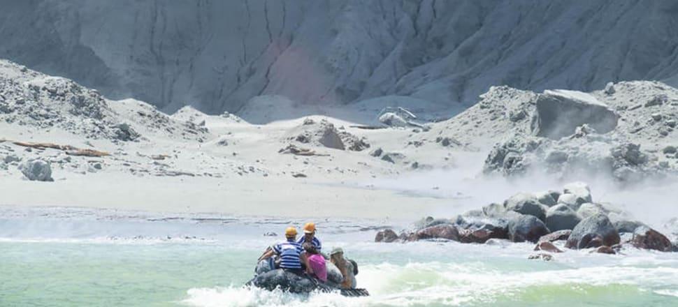 White Island Tours staff rescuing survivors after the eruption.  Photo: Michael Schade
