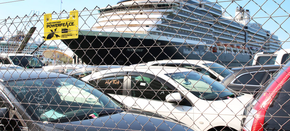 A Holland America line cruise ship docked at Queens Wharf on the Auckland waterfront, alongside parked imported used cars that are also used by domestic and international tourists. Photo: Lynn Grieveson
