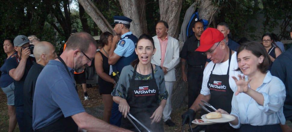 Jacinda Ardern mans the Waitangi Day BBQ with Andrew Little, Kelvin Davis and Chloe Swarbrick. Photo: Sam Sachdeva.