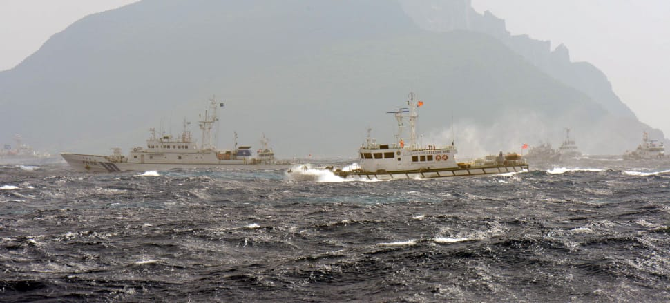 Japanese and Taiwanese coastguard vessels facing off in the waters around the Senkaku Islands. Photo: Getty