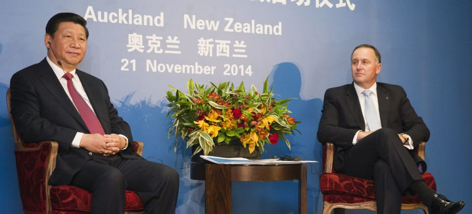 China's President Xi Jinping with former National Prime Minister John Key. Photo: Getty Images