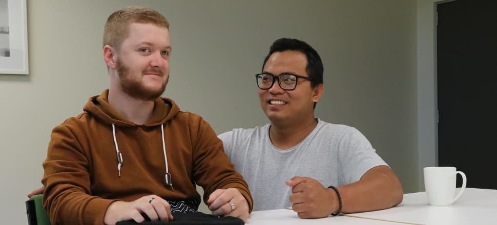 Bret Genet-Rentoul, left, says he has become friends with his CCS Disability Action support worker Andry Rianto. Photo: David Williams