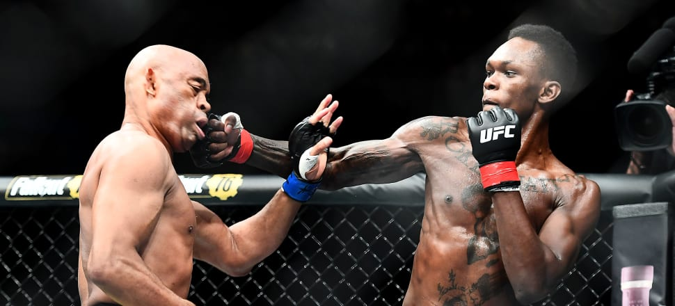 Kiwi UFC star Israel Adesanya lands a right hand in his victory over former champion Anderson Silva. Photo: Getty Images
