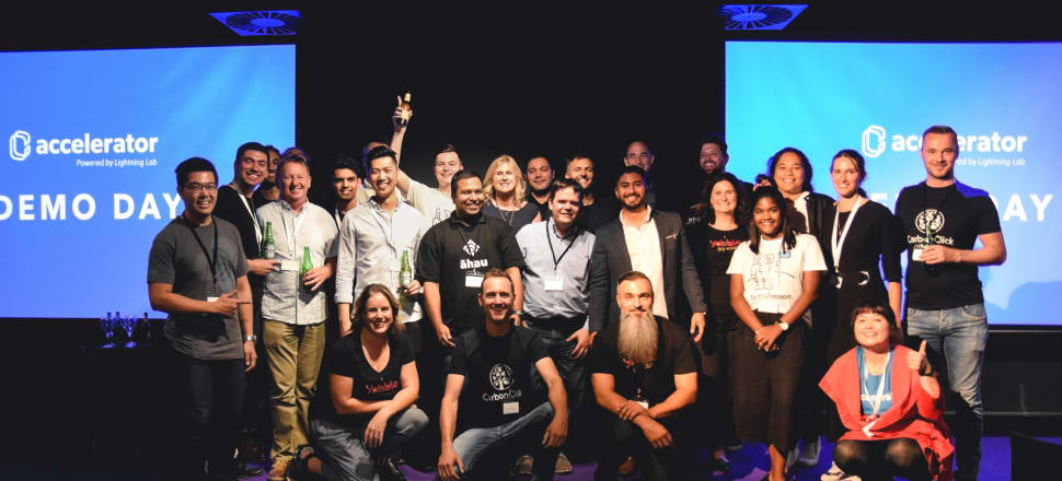 Teams from Centrality.ai's first accelerator programme celebrate on stage at its Demo Day at GridAKL. Photo: Supplied