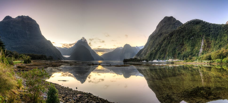New DOC staff will be tasked with finding a way for high-volume tourist areas, like Milford Sound, to cope with a predicted surge in visitors. Photo: Getty Images