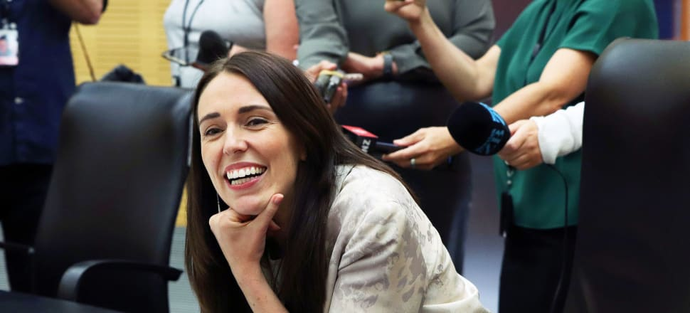 Jacinda Ardern kicks off the first Cabinet meeting of the year with a grin. Photo: Lynn Grieveson