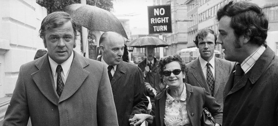 Shirley Smith in 1975, at the Supreme Court in Wellington, with (l-r) Mike Bungay, her husband Bill Sutch, Michael Huston, and Ian Greig (Alexander Turnbull Library).