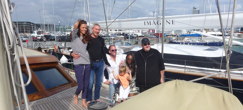 Mikhail Khimich with his girlfriend, Belarussian model Maria Dzidirava, and Kim Dotcom on Khimich's super yacht Thalia. Photo: Supplied