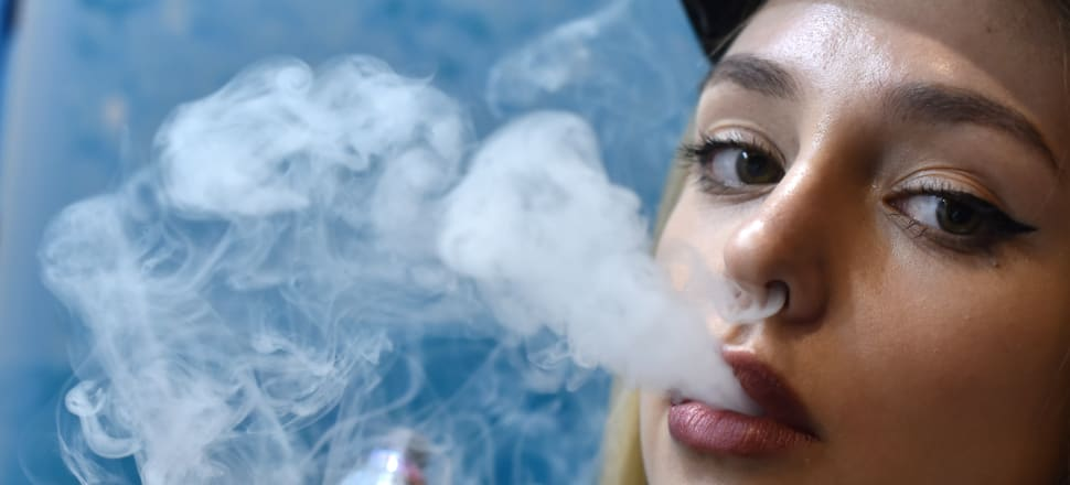 Vaping is said to be 95 percent less harmful than smoking. That doesn't necessarily make it safe. Photo: Getty Images