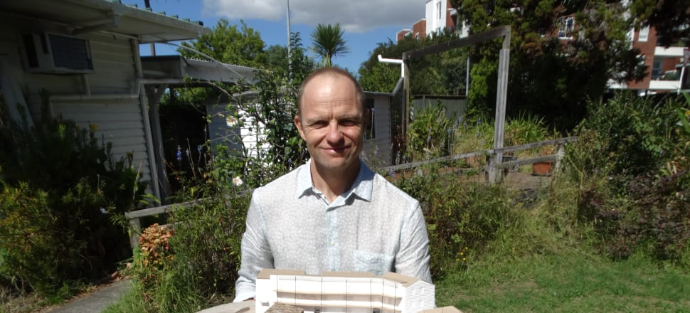 Thom Gill with a model of Cohaus, in the grounds of the Surrey Cres property. Photo: Alexia Russell