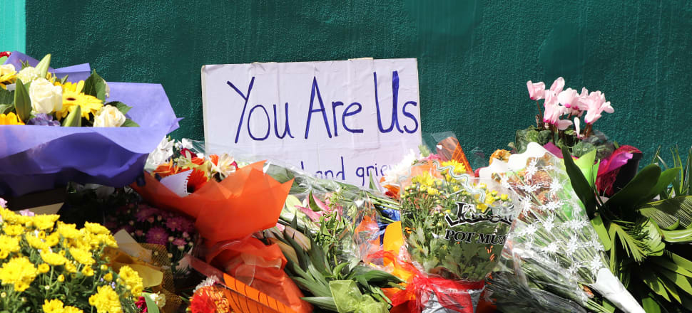 Flowers and signs in front of the Wellington Islamic Centre and mosque in Kilbirnie following the Christchurch terrorist attack. Photo: Lynn Grieveson