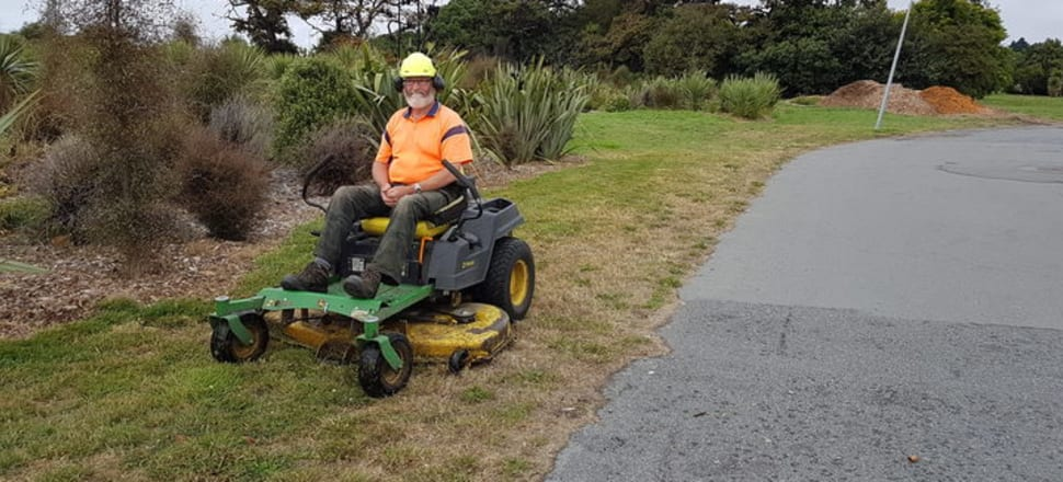Brian Fairbairn on his mower Photo: RNZ/Katy Gosset