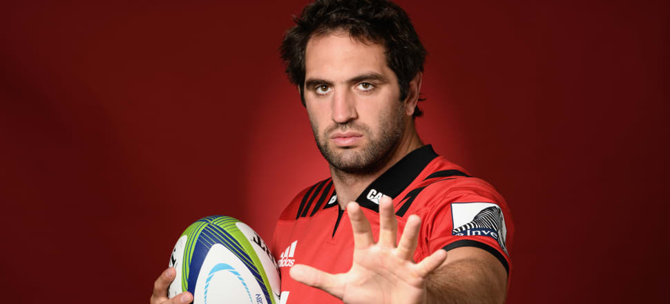 Sam Whitelock complies with a photographer's request to adopt a slightly awkward pose at a Crusaders photo shoot. Photo: Getty Images