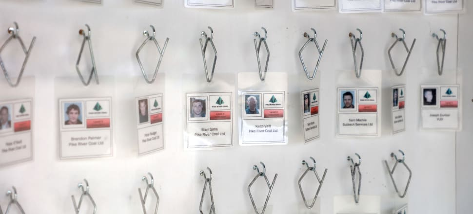 The ID cards of the 29 men whose bodies remain in the Pike River Mine now form part of a memorial. Photo: Getty Images